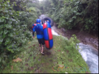 walking along the blue river to start tubing