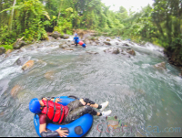 lady floating on a tube getting ready to enter the rapids blue river rincon de la vieja