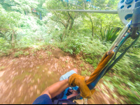on a cable from land to the canyon entrance at the white river canyon zip line rincon de la vieja