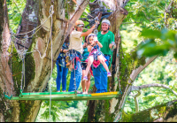 kid riding by herself from a tree platform tizati zip line rincon de la vieja