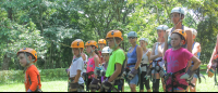 children listening to instructions to do canopy tour