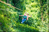 lady riding with a guide superman style tizati zip line rincon de la vieja