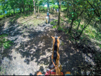 at the tip of a hill drapped in forest horseback riding rincon de la vieja
