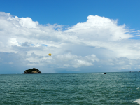 parasailing in the distance 