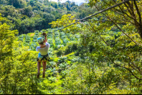 lady zip lining the first cable osa palmas canopy tour