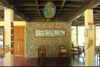 art on wall restaurant interior gilded iguana
