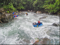 guide tubing down the currents of blue river to join the group rincon de la vieja