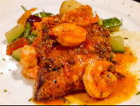 fish shrimp and over sauteed vegetables