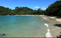 Manuel Antonio Beach   white sand and calm blue water