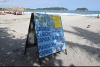 el ancla sign on beach 