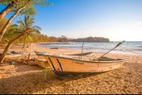 fishing boat on the sand of playa pelada in nosara
