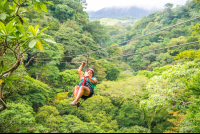 lady on a forested cable tizati zip line ricon de la vieja