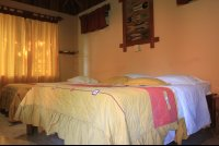ritmo tropical hotel beds on bungalow