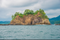 rocky island in the northern area of tamarindo bay from the marlin del ray catamaran