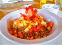 diced fruit over granola and yogourt on the site
