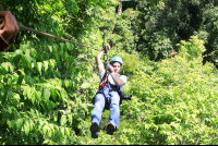 man ziplining on suntrails canopy tour  - Costa Rica