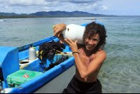 Jessica Russo, a dive master at Reef Runner Divers, unloads scuba tanks after diving