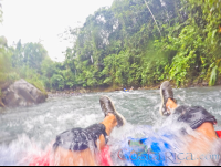 soaking in blue river waters on an inner tube rincon de la vieja