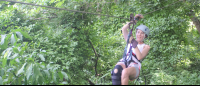 girl ziplining on canopy mal pais tour