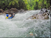 kid tubing in the rapids of the blue river rincon de la vieja