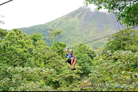 zip lining with arenal volcano base in the background los canones canopy tour la fortuna