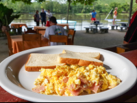 scramble eggs with ham and toast at perla del sur restaurant