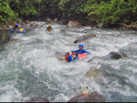 going down the currents of blue river on an inner tube rincon de la vieja