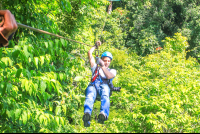 man ziplining on suntrails canopy tour
