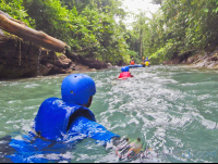 wading in the blue river to get inner tube rincon de la vieja