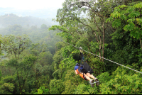 A visitor rides a zip line on the Superman de Osa tour  - Costa Rica
