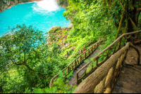 step trail railing with the view of the blue pool celeteste river waterfall tour