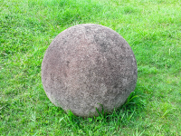 costa rica stone sphere on the grass at finca 