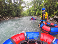 tubing in a section of calm water blue river rincon de la vieja