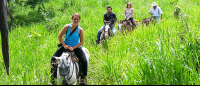 horseback riders going up a hill  - Costa Rica