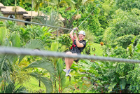 flying above the resort los lagos on a zip line los canones canopy tour la fortuna