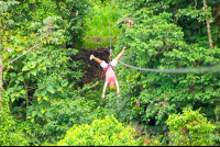 a man zip lining upside down los canones canopy tour la fortuna