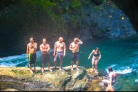 portalon waterfall people standing on rocks waterfall tour manuel antonio