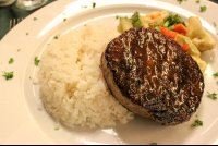 grilled steak with rice and vegetables at mastico restaurant 