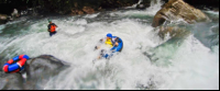 kid tubing in the rapids of blue river rincon de la vieja