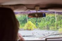 view from the car crossing a river to access los patos ranger station
