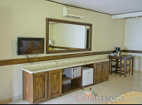 other premium room bedroom tv shelves mirror safe and small fridge hotel los lagos  - Costa Rica