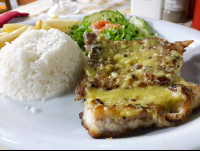 grilled fish over garlic sauce at perla del sur restaurant