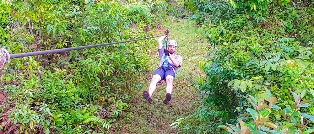 man zip linning on corcovado canopy tour