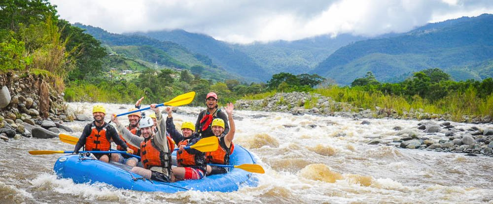 grande de orosi whitewater rafting rafting with mountain background