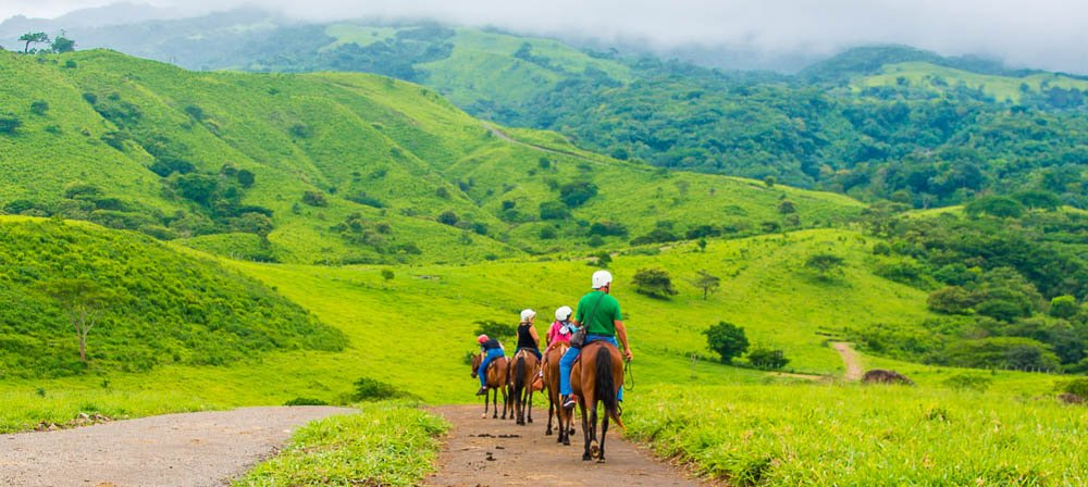 group descending to tizati river valley horseback ride tour western side of rincon de la vieja volcano
